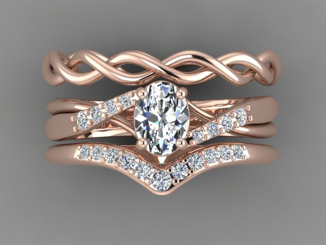 Rose gold diamond engagement ring with bypass tapered pave and matching wedding bands