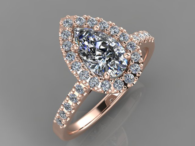 Rose gold engagement ring with pear shape diamond