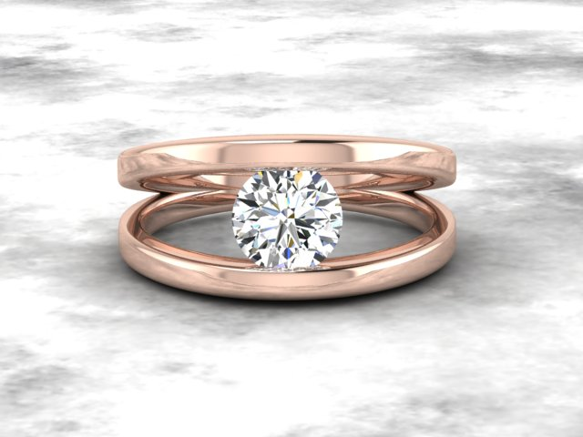 Rose gold engagement ring with round brilliant cut diamond in tension setting