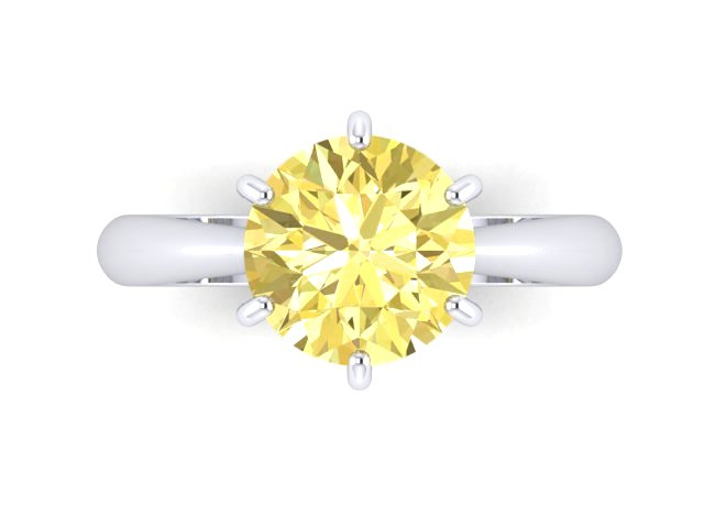 White gold engagement ring with light fance yellow round diamond
