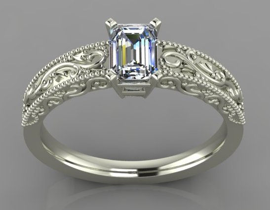 White gold ring with emerald cut diamond and filigree on sides